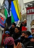 speakers on the steps of Parliament Hill for the #IdleNoMore rally. People packed the stairs rendering the concrete below their feet unseeable. (Ottawa, Canada)